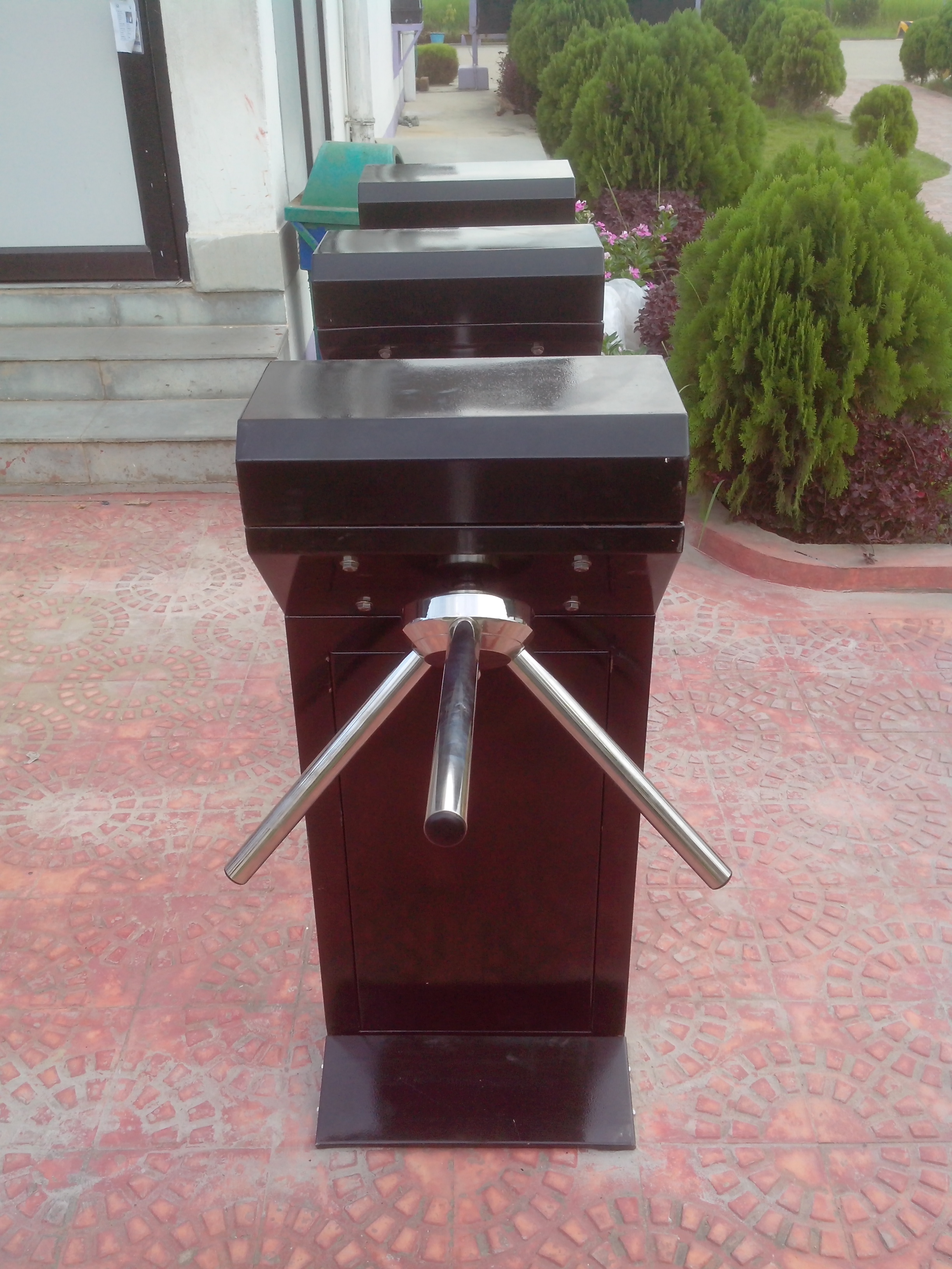 Drop arm motorized tripod turnstiles manufactures and